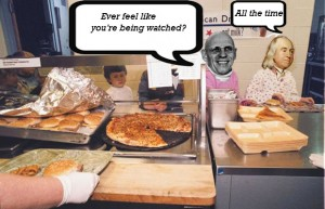"A shot of a school cafeteria. Two children are pushing their trays down the counter. One has Michel FOucault's head and the other has Jeremy Bentham's. Foucault has a thought bubble that says ""Ever feel like you are being watched?"" Bentham has a bubble that says ""All the time."""